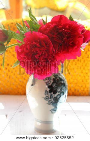 Claret Peonies In A Vase