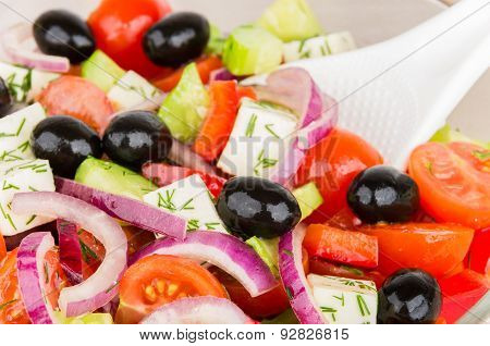 Close Up Of Greek Salad And Spoon