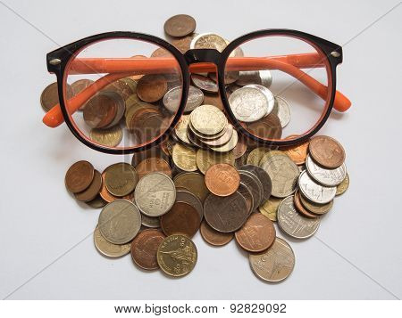 Eyeglasses on baht coins,Backgrounds.