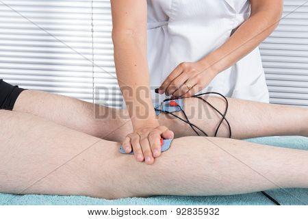 Man With Electrostimulator Electrodes On His Body
