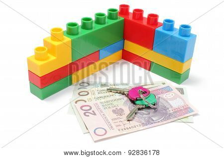 Wall Of Plastic Colorful Building Blocks With Home Keys And Money
