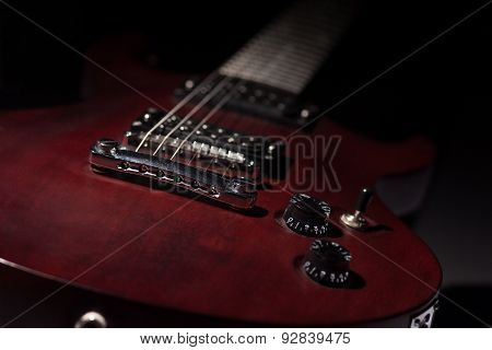 Red Electric Guitar On A Black Background