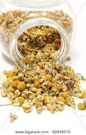 Heap Of Dried Camomile In Glass Jar