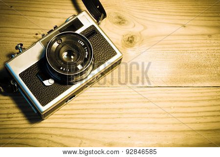 Vintage Analog Camera On A Rustic Wooden Background