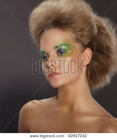 Portrait Of Young Woman With Creative Makeup