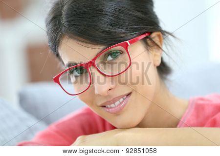 Portrait of beautiful brunette girl wearing red eyeglasses