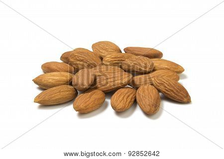 heap of peeled almond nuts isolated on white