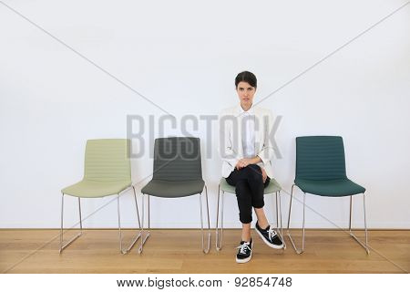 Job applicant sitting in waiting room, interview day