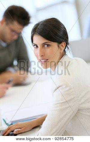 Portrait of attractive businesswoman in meeting room