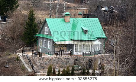 House On The Hill. Pechory Monastery, Pskov Region, Russia