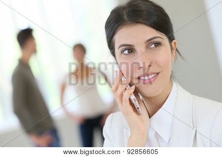 Portrait of corporate woman talking on phone