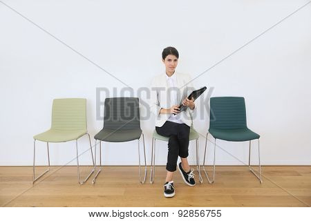 Woman sittin on chair waiting for job interview