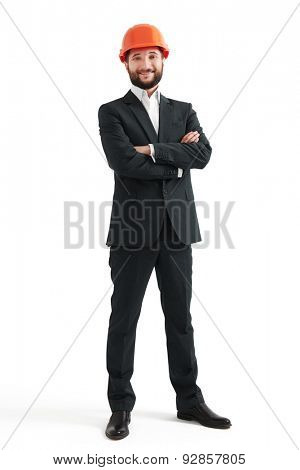 smiley man in formal wear and orange hard hat. isolated on white background