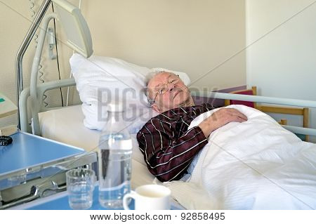 Elderly Man Recuperating In A Hospital