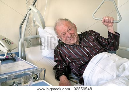 Frail Senior Man In A Hospital Bed