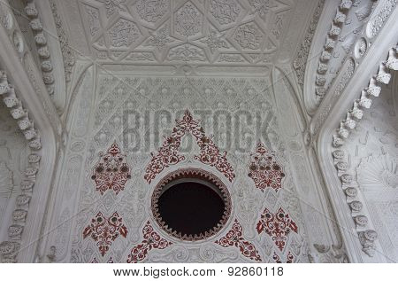 Red decoration on a white wall