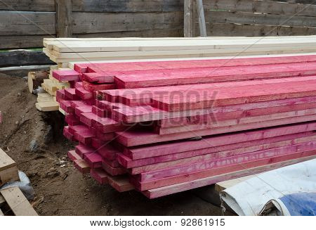 stacked wood boards treated with antiseptic spray