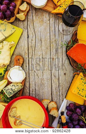 Cheese, founde - different types of cheese on a wooden background