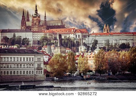 View of old town and Prague castle with river Vltava at sunset