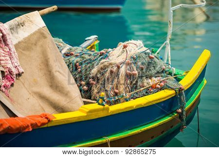 fishing nets in a traditional colorful Marsaxlokk fishing boat