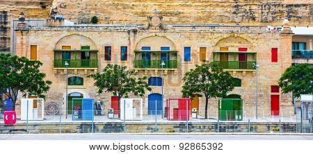colorful doors and windows in Valletta embankment street in Malta