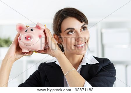 Piggibank And Woman