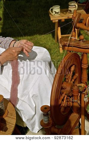 Lady spinning yarn from wool
