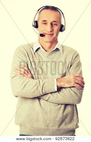 Mature call center man wearing headset.
