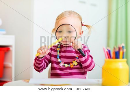Funny Toddler Girl Playing With Magnifier
