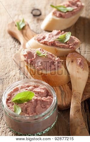 healthy chicken liver pate with sage in jar and on bread