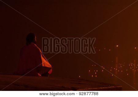 Indian Sadhu Meditating In Sacred River Ganges  At Night