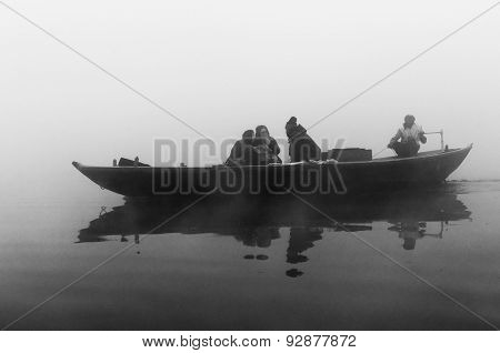 Indian Tourists  Sailing On Boat On The River Ganges At Cold Foggy Winter Morning. Varanasi