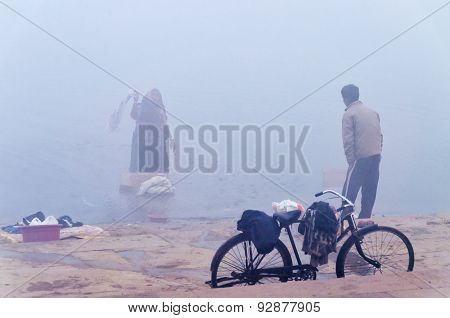 On The Bank Of The Sacred River Ganges At Cold Foggy Winter Morning. Varanasi