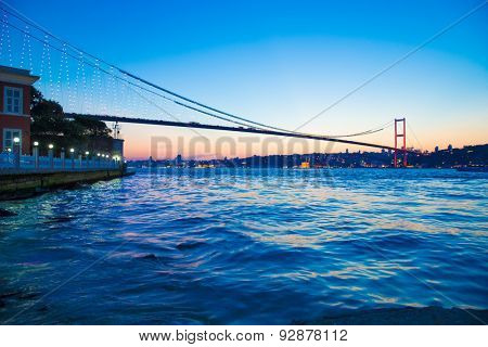 Bosporus Bridge at night with lights in Istanbul, Turkey