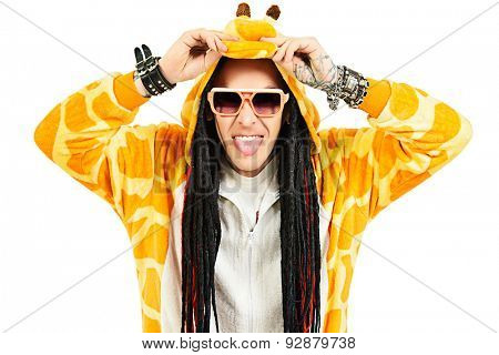 Rock musician in a costume of giraffe dancing and singing at studio. Zoo party. Entertainment, rock show. Isolated over white.