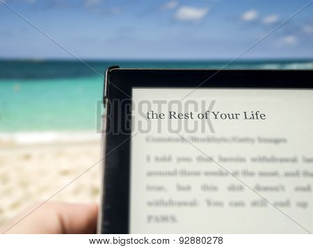 Reading On The Beach With The Title