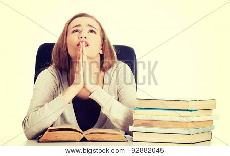 Woman praying to pass the exam.