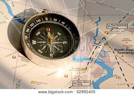An old compass and the travelling map guide.