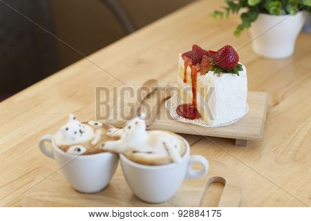 Latte Coffee Topping Made By Milk Foam Top On The Cup Of Hot Coffee And Strawberry Cake