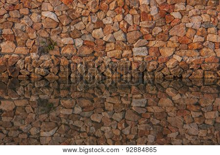 Wall Stones And Water Reflection.