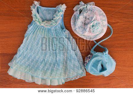 Summer children's clothing: dress, purse, hat,