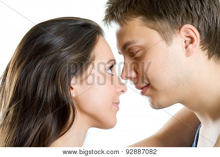 Young Man And Woman Looking For Tenderness And Closeness