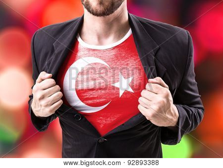 Businessman stretching suit with Turkish Flag on bokeh background