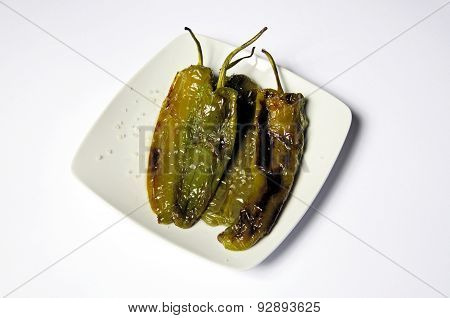 Fried Italian pointed peppers sprinkled with sea.
