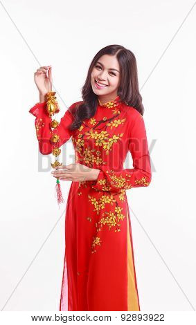Beautiful Vietnamese Woman With Red Ao Dai Holding Lucky Decorate Object For Celebrate Lunar New Yea