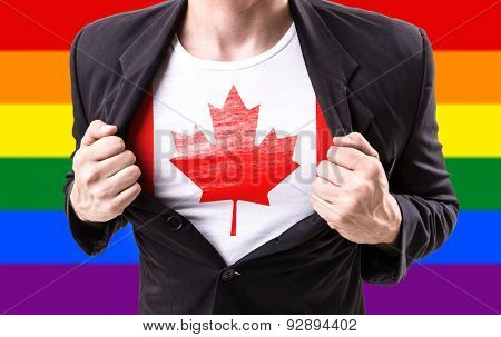 Businessman stretching suit with Canada Flag with rainbow flag