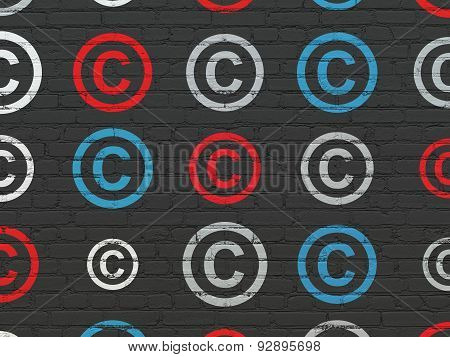 Law concept: Copyright icons on wall background