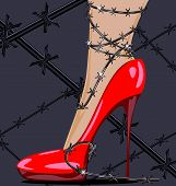 stock photo of big-foot  - womans feet in red shoes and barbed wire - JPG