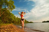 image of bathing  - beautiful girl in a bathing suit standing on the shore of the beach - JPG