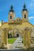 stock photo of turret arch  - An Opened Gate to the Church Yard Szekesfehervar Hungary - JPG
